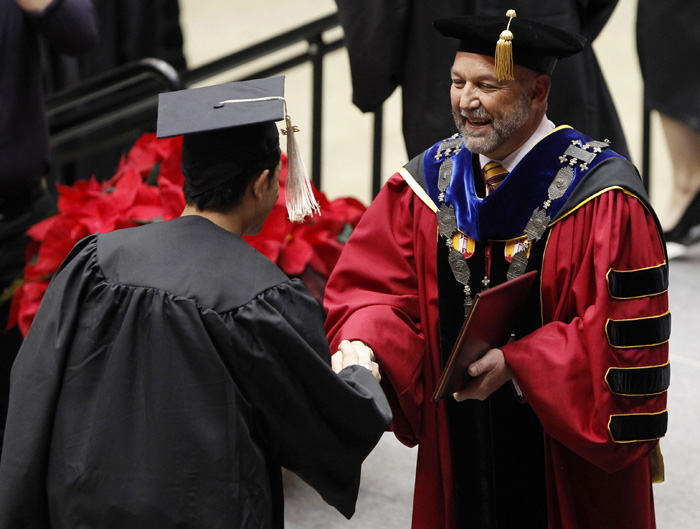 President Leath awards a degree at fall 2014 commencement