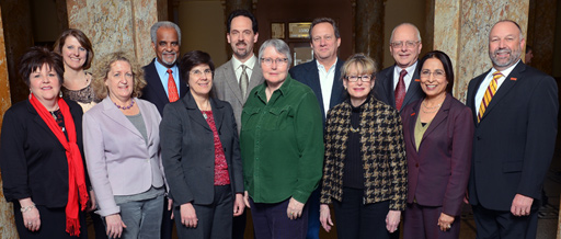 Members of the Committee on Enhancing Institutional Excellence and President Steven Leath